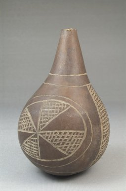 <em>Calabash</em>, before 1922. Calabash, clay, height: 4 15/16 in. (12.5 cm); diameter: 3 1/16 in. (7.8 cm). Brooklyn Museum, Museum Expedition 1922, Robert B. Woodward Memorial Fund, 22.514. Creative Commons-BY (Photo: Brooklyn Museum, CUR.22.514_front_PS5.jpg)