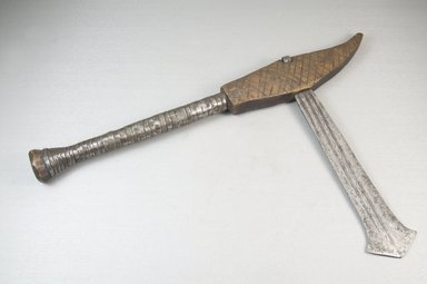 Mangbetu ?. <em>Axe with Blade and Handle</em>, late 19th century. Iron, wood, metal strips, 8 9/16 x 13 3/4 in. (21.7 x 35 cm). Brooklyn Museum, Museum Expedition 1922, Robert B. Woodward Memorial Fund, 22.583. Creative Commons-BY (Photo: Brooklyn Museum, CUR.22.583_threequarter_PS5.jpg)
