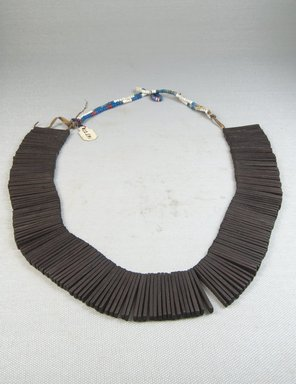 <em>Necklace</em>, before 1922. Wood, length: 29 1/2 in. (75 cm). Brooklyn Museum, Museum Expedition 1922, Robert B. Woodward Memorial Fund, 22.591. Creative Commons-BY (Photo: Brooklyn Museum, CUR.22.591_front_PS5.jpg)