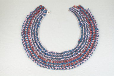Xhosa (Thembu subgroup). <em>Collar (Ingqosha)</em>, early 20th century. Glass beads, natural fiber, button, 20 3/4 x 2 in. (52.7 x 5.1 cm). Brooklyn Museum, Gift of Thomas A. Eddy, 22.592. Creative Commons-BY (Photo: Brooklyn Museum, CUR.22.592_front_PS5.jpg)