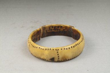 <em>Bracelet, Broken</em>. Ivory Brooklyn Museum, Museum Expedition 1922, Robert B. Woodward Memorial Fund, 22.629. Creative Commons-BY (Photo: Brooklyn Museum, CUR.22.629_front_PS5.jpg)