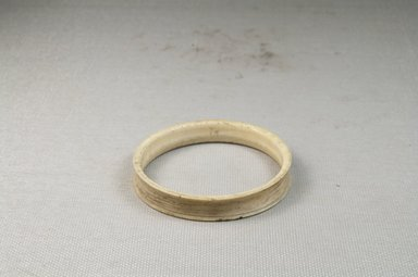 <em>Bracelet</em>. Plain ivory Brooklyn Museum, Museum Expedition 1922, Robert B. Woodward Memorial Fund, 22.633. Creative Commons-BY (Photo: Brooklyn Museum, CUR.22.633_front_PS5.jpg)