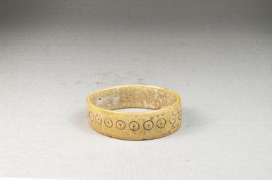 <em>Bracelet</em>. Engraved ivory Brooklyn Museum, Museum Expedition 1922, Robert B. Woodward Memorial Fund, 22.637. Creative Commons-BY (Photo: Brooklyn Museum, CUR.22.637_front_PS5.jpg)