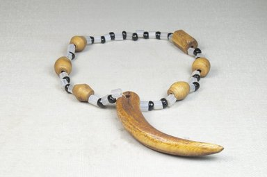 <em>Wristlet</em>, early 20th century. Glass beads, ivory beads, one tooth, tooth: 3 3/8 x 12 3/16 in. (8.5 x 31 cm). Brooklyn Museum, Museum Expedition 1922, Robert B. Woodward Memorial Fund, 22.650. Creative Commons-BY (Photo: Brooklyn Museum, CUR.22.650_front_PS5.jpg)