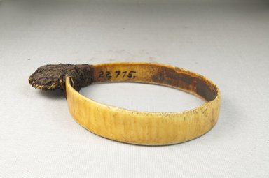 <em>Bracelet, Ornament</em>. Plain ivory, fiber bag Brooklyn Museum, Museum Expedition 1922, Robert B. Woodward Memorial Fund, 22.775. Creative Commons-BY (Photo: Brooklyn Museum, CUR.22.775_front_PS5.jpg)