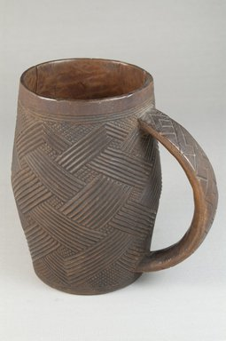 Kuba (Bushoong subgroup). <em>Cup</em>, early 20th century. Wood, height: 5 5/16 in. (13.5 cm); diameter: 3 1/16 in. (7.8 cm). Brooklyn Museum, Museum Expedition 1922, Robert B. Woodward Memorial Fund, 22.799. Creative Commons-BY (Photo: Brooklyn Museum, CUR.22.799_front_PS5.jpg)