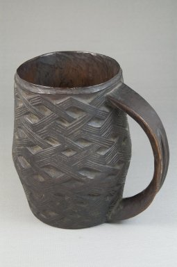 Kuba. <em>Cup</em>, late 19th or early 20th century. Wood, 6 3/4 x 3 3/8 x 3 3/8 in. (17.1 x 8.6 x 8.6 cm). Brooklyn Museum, Museum Expedition 1922, Robert B. Woodward Memorial Fund, 22.800. Creative Commons-BY (Photo: Brooklyn Museum, CUR.22.800_front_PS5.jpg)