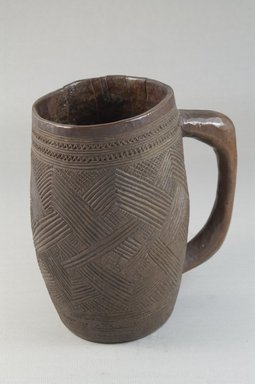 Kuba. <em>Cup</em>, early 20th century. Wood, height: 5 11/16 in. (14.5 cm); diameter: 3 3/8 in. (8.6 cm). Brooklyn Museum, Museum Expedition 1922, Robert B. Woodward Memorial Fund, 22.803. Creative Commons-BY (Photo: Brooklyn Museum, CUR.22.803_front_PS5.jpg)