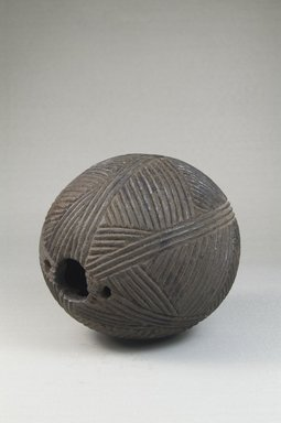 Tetela. <em>Oil Container</em>, late 19th century. Coconut shell, 5 x 5 x 5 in. (12.7 x 12.7 x 12.7 cm). Brooklyn Museum, Museum Expedition 1922, Robert B. Woodward Memorial Fund, 22.819. Creative Commons-BY (Photo: Brooklyn Museum, CUR.22.819_threequarter_PS5.jpg)