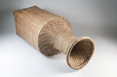 <em>Cassava Sifter</em>, early 20th century. Vegetal fiber, 18 x 4 7/8 in. (45.8 x 12.5 cm). Brooklyn Museum, Museum Expedition 1922, Robert B. Woodward Memorial Fund, 22.831. Creative Commons-BY (Photo: Brooklyn Museum, CUR.22.831_threequarter_PS5.jpg)