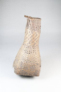 <em>Bottle-shaped Basket</em>, early 20th century. Vegetal fiber, 8 1/4 x 3 3/4 in. (21.0 x 9.0 cm). Brooklyn Museum, Museum Expedition 1922, Robert B. Woodward Memorial Fund, 22.843. Creative Commons-BY (Photo: Brooklyn Museum, CUR.22.843_front_PS5.jpg)
