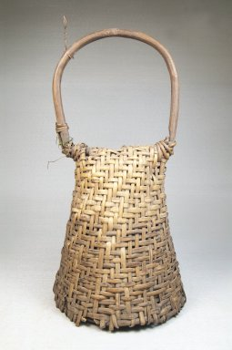 <em>Basket Rattle with Hoop Handle-Dance Rattle</em>, late 19th or early 20th century. Rattan, calabash, 11 1/2 x 5 3/4 in. (31.8 x 14.6 cm). Brooklyn Museum, Museum Expedition 1922, Robert B. Woodward Memorial Fund, 22.844. Creative Commons-BY (Photo: Brooklyn Museum, CUR.22.844_front_PS5.jpg)