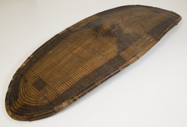 Ngbandi. <em>Shield</em>, late 19th century. Fiber, wood, wire, 37 × 14 3/16 in. (94 × 36 cm). Brooklyn Museum, Museum Expedition 1922, Robert B. Woodward Memorial Fund, 22.846. Creative Commons-BY (Photo: Brooklyn Museum, CUR.22.846_front_PS5.jpg)