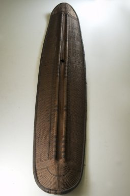 Konda, Mongo. <em>Shield</em>, late 19th century. Fiber, wood, 53 1/8 x 9 7/16 in. (135 x 24 cm). Brooklyn Museum, Museum Expedition 1922, Robert B. Woodward Memorial Fund, 22.853. Creative Commons-BY (Photo: Brooklyn Museum, CUR.22.853_front_PS5.jpg)