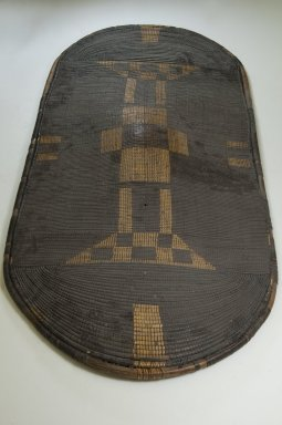 Zande. <em>Shield</em>, late 19th century. Fiber, wood, 46 7/8 x 22 1/16 in. (119.1 x 56 cm). Brooklyn Museum, Museum Expedition 1922, Robert B. Woodward Memorial Fund, 22.856. Creative Commons-BY (Photo: Brooklyn Museum, CUR.22.856_front_PS5.jpg)