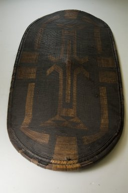Zande. <em>Shield</em>, late 19th century. Fiber, wood., 43 11/16 x 20 1/16 in. (111 x 51 cm). Brooklyn Museum, Museum Expedition 1922, Robert B. Woodward Memorial Fund, 22.857. Creative Commons-BY (Photo: Brooklyn Museum, CUR.22.857_front_PS5.jpg)