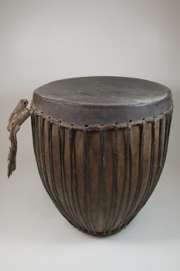 <em>Drum</em>, late 19th or early 20th century. Wood, hide, leather, 18 1/2 x 16 1/8 x 16 1/8 in. (47 x 41 x 41 cm). Brooklyn Museum, Museum Expedition 1922, Robert B. Woodward Memorial Fund, 22.887. Creative Commons-BY (Photo: Brooklyn Museum, CUR.22.887_front_PS5.jpg)