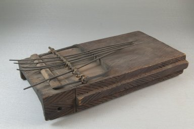 <em>Plucked Idiophone (Sanza)</em>, late 19th or early 20th century. Engraved wood, metal, 2 1/2 x 9 x 5 in. (6.4 x 22.9 x 12.7 cm). Brooklyn Museum, Museum Expedition 1922, Robert B. Woodward Memorial Fund, 22.891. Creative Commons-BY (Photo: Brooklyn Museum, CUR.22.891_threequarter_PS5.jpg)