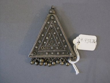 <em>Pendant</em>. metal, 1 3/4 x 2 1/4 in. (4.4 x 5.7 cm). Brooklyn Museum, 24.437.76 (Photo: Brooklyn Museum, CUR.24.437.76.jpg)