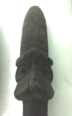 Maori. <em>Staff (Taiaha)</em>. Wood, 69 5/16 x 2 3/16 x 1 3/8 in.  (176.0 x 5.5 x 3.5 cm). Brooklyn Museum, Bequest of Samuel E. Haslett, 24376. Creative Commons-BY (Photo: Brooklyn Museum, CUR.24376_detail.jpg)