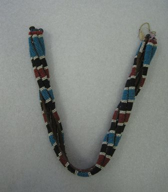 Zulu. <em>Girdle</em>, mid to late 19th century. Glass beads, natural fiber, brass, 28 x 2in. (71.1 x 5.1cm). Brooklyn Museum, Gift of Robert Sharp Kunkel, 25.804. Creative Commons-BY (Photo: Brooklyn Museum, CUR.25.804_overall.jpg)