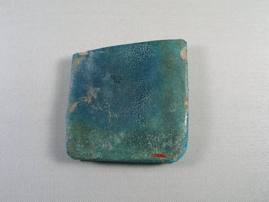<em>Tile Fragment</em>, ca. 1352-1336 B.C.E. Faience, 4 1/8 × 5/8 × 4 3/16 in. (10.5 × 1.6 × 10.6 cm). Brooklyn Museum, Gift of the Egypt Exploration Society, 25.880. Creative Commons-BY (Photo: , CUR.25.880_view01.jpg)