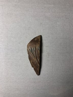 <em>Toilet Spoon Fragment</em>, ca. 1352-1332 B.C.E. Wood, paste?, 2 13/16 × 1 in. (7.2 × 2.5 cm). Brooklyn Museum, Gift of the Egypt Exploration Society, 25.886.13. Creative Commons-BY (Photo: , CUR.25.886.13_view01.jpg)