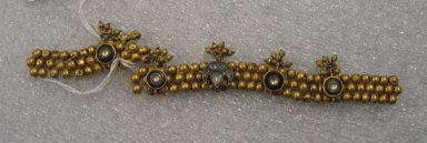 <em>Bracelet or Necklace Fragment</em>. Brass, beads, glass, 7 1/16 x 7/8 in. (18 x 2.2 cm). Brooklyn Museum, 25600. Creative Commons-BY (Photo: Brooklyn Museum, CUR.25600_front.jpg)