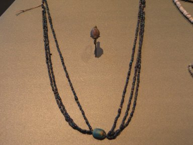 <em>Three Strand Necklace with Scarab</em>, ca. 1630-1539 B.C.E. Steatite, glaze, Length of scarab: 1 11/16 in. (4.3 cm). Brooklyn Museum, Gift of the Egypt Exploration Society, 26.162. Creative Commons-BY (Photo: Brooklyn Museum, CUR.26.162_erg2.jpg)