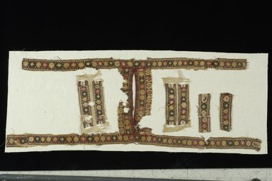 Coptic. <em>Tunic Fragments</em>, 6th century C.E. Flax, wool, 26.747a: 14 3/16 × 36 5/8 in. (36 × 93 cm). Brooklyn Museum, Gift of the Long Island Historical Society, 26.747. Creative Commons-BY (Photo: Brooklyn Museum (in collaboration with Index of Christian Art, Princeton University), CUR.26.747_ICA.jpg)