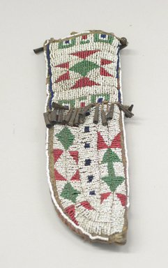 Oglala, Lakota, Sioux. <em>Beaded Knife Sheath, Part of War Outfit</em>, ca. 1880. Hide, beads, metal, sinew, 3 x 10 in. (7.6 x 25.4 cm). Brooklyn Museum, Robert B. Woodward Memorial Fund, 26.789. Creative Commons-BY (Photo: Brooklyn Museum, CUR.26.789.jpg)