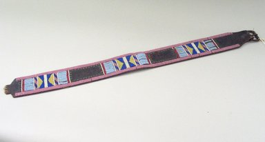 Sekani. <em>Beaded Belt, Part of War Outfit</em>, 1880-1900. Commercial hide, beads, nails, metal, sinew, 33 1/2 x 3 in. or (82 x 8 cm). Brooklyn Museum, Robert B. Woodward Memorial Fund, 26.790. Creative Commons-BY (Photo: Brooklyn Museum, CUR.26.790_view1.jpg)
