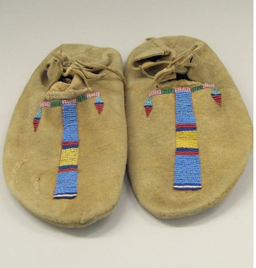 Cheyenne. <em>Pair of Moccasins, Part of War Outfit</em>, late 19th-early 20th century. Hide, beads, pigment, 10 13/16 x 4 3/4 in. (27.5 x 12.1 cm). Brooklyn Museum, Robert B. Woodward Memorial Fund, 26.794a-b. Creative Commons-BY (Photo: Brooklyn Museum, CUR.26.794a-b.jpg)