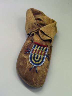 Blackfoot (probably). <em>Moccasin with Blue,Yellow, White and Red Beading</em>, 1880-1890. Hide, beads, pigment., 6 11/16 x 4 5/16 x 11 7/16in. (17 x 11 x 29cm). Brooklyn Museum, Robert B. Woodward Memorial Fund, 26.795. Creative Commons-BY (Photo: Brooklyn Museum, CUR.26.795.jpg)