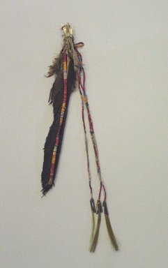 Oglala, Lakota, Sioux. <em>Two Tassels, Part of War Outfit</em>, late 19th-early 20th century. Hide, porcupine quills, metal, 13 3/8in. (34cm). Brooklyn Museum, Robert B. Woodward Memorial Fund, 26.798. Creative Commons-BY (Photo: Brooklyn Museum, CUR.26.798.jpg)
