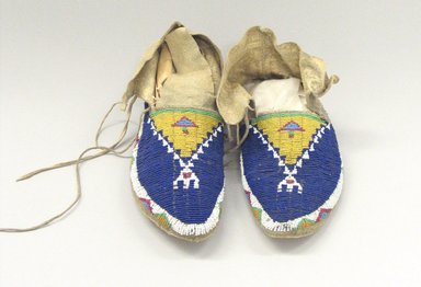 Oglala, Lakota, Sioux. <em>Pair of Beaded Moccasins</em>, late 19th-early 20th century. Buckskin, rawhide, beads, a: 9 x 3 1/2 x 4 (23.0 x 9.0 cm). Brooklyn Museum, Robert B. Woodward Memorial Fund, 26.805a-b. Creative Commons-BY (Photo: Brooklyn Museum, CUR.26.805a-b_view1.jpg)