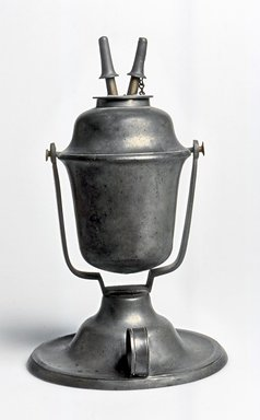 American. <em>Lamp</em>, ca. 1840. Pewter, 8 3/8 x 5 1/4 x 5 1/4 in. (21.3 x 13.3 x 13.3 cm). Brooklyn Museum, Gift of Mrs. Samuel Doughty, 27.521. Creative Commons-BY (Photo: Brooklyn Museum, CUR.27.521_view1.jpg)