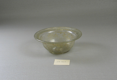 Roman. <em>Bowl</em>, 1st-2nd century C.E. Glass, 1 7/16 x Diam. 4 1/4 in. (3.7 x 10.8 cm). Brooklyn Museum, Anonymous gift, 27.726. Creative Commons-BY (Photo: Brooklyn Museum, CUR.27.726.jpg)