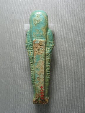 <em>Ushabti</em>, 664-332 B.C.E. Faience, 6 13/16 x 2 x 1 1/2 in. (17.3 x 5.1 x 3.8 cm). Brooklyn Museum, Gift of the Long Island Historical Society, 28.524. Creative Commons-BY (Photo: Brooklyn Museum, CUR.28.524_view6.jpg)