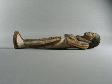 <em>Ushabti</em>, ca. 1539-1292 B.C.E. Faience, 8 3/4 x 2 1/4 x 1 7/8 in. (22.3 x 5.7 x 4.7 cm). Brooklyn Museum, Gift of the Long Island Historical Society, 28.527. Creative Commons-BY (Photo: Brooklyn Museum, CUR.28.527_view2.jpg)