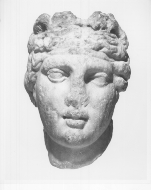 Roman. <em>Head of Aphrodite</em>. Marble, 5 1/4 × 3 1/2 × 4 in. (13.3 × 8.9 × 10.2 cm). Brooklyn Museum, Gift of Bianca Olcott in memory of her father, Professor George M. Olcott of Columbia University, of her grandfather, George N. Olcott, and of her great-grandfather, Charles M. Olcott, President of the Brooklyn Institute of Arts and Sciences 1851-1853, 29.1604. Creative Commons-BY (Photo: Brooklyn Museum, CUR.29.1604_NegA_print_bw.jpg)