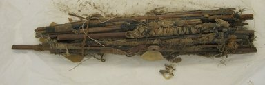 <em>Canes Wound with Cotton and Plaited Grass Necklace or Canes Wrapped with Yarn</em>, 1000-1400. Cane, cotton, grass fiber, shell, pigment, animal tooth, 5 x 2 1/2 x 23 3/4 in. (12.7 x 6.4 x 60.3 cm). Brooklyn Museum, Gift of Clarence B. Moore, 2966. Creative Commons-BY (Photo: Brooklyn Museum, CUR.2966.jpg)