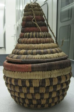 Amhara. <em>Bottle-shaped Basket with Conical Top</em>, early 20th century. Fiber, height: (25.0 cm). Brooklyn Museum, Gift of Lucy Addoms, 30.1216a-b. Creative Commons-BY (Photo: Brooklyn Museum, CUR.30.1216a-b_side.jpg)