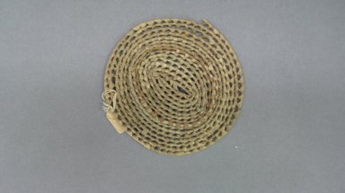 <em>Basketry Lid</em>, early 20th century. Reed, grass, diam.: 4 3/16 in. (12.2 cm). Brooklyn Museum, Gift of Lucy Addoms, 30.1230. Creative Commons-BY (Photo: Brooklyn Museum, CUR.30.1230.jpg)