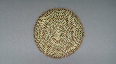 <em>Basketry Lid</em>, early 20th century. Reed, raffia, diam.:10 3/4 in. ( 27.3 cm). Brooklyn Museum, Gift of Lucy Addoms, 30.1239. Creative Commons-BY (Photo: Brooklyn Museum, CUR.30.1239.jpg)
