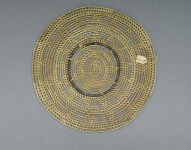 <em>Basketry Lid</em>, early 20th century. Reed, grass, diam: 12 5/8 in. ( 32.0 cm.). Brooklyn Museum, Gift of Lucy Addoms, 30.1240. Creative Commons-BY (Photo: Brooklyn Museum, CUR.30.1240.jpg)