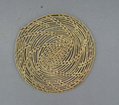 <em>Basketry Lid</em>, early 20th century. Reed, grass, diam.: 6 7/8 in. (17.5 cm). Brooklyn Museum, Gift of Lucy Addoms, 30.1248. Creative Commons-BY (Photo: Brooklyn Museum, CUR.30.1248.jpg)