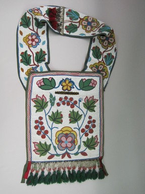 Anishinaabe (Ojibwa), Gawababiganikak. <em>Bandolier Bag</em>, late 19th - early 20th century. Beads, cloth, silk, wool, 35 × 14 1/4 in. (88.9 × 36.2 cm). Brooklyn Museum, Museum Collection Fund, 30.1471. Creative Commons-BY (Photo: , CUR.30.1471.jpg)