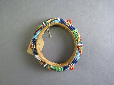 Zulu ?. <em>Beaded Bracelet</em>, early 20th century. Glass bead, leather, cloth, natural fiber, 2 1/2 x 2 1/2in. (6.4 x 6.4cm). Brooklyn Museum, Gift of Elizabeth Schulz, 30.1472. Creative Commons-BY (Photo: Brooklyn Museum, CUR.30.1472_top.jpg)