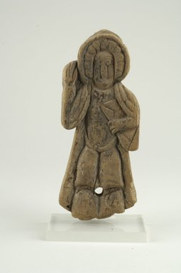 Coptic. <em>Figure of a Saint Holding Book in Left Hand</em>, 10th-11th century C.E. Wood, 3 3/8 x 3/4 x 8 9/16 in. (8.6 x 1.9 x 21.8 cm). Brooklyn Museum, Gift of Ruth Tishner Costantino, 30.27. Creative Commons-BY (Photo: Brooklyn Museum (in collaboration with Index of Christian Art, Princeton University), CUR.30.27_view1_ICA.jpg)